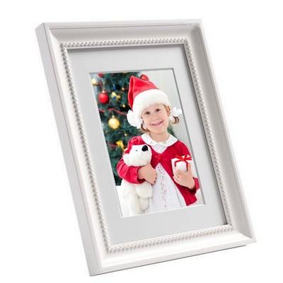 Photo 10x15 encadrée - cadre blanc perlé 18x23